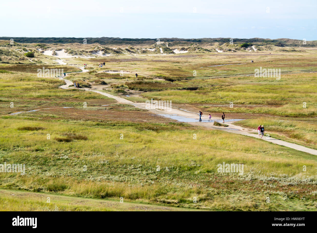 People walking in dune valley the Slufter of national park on West Frisian Waddensea island Texel, North Holland, Stock Photo