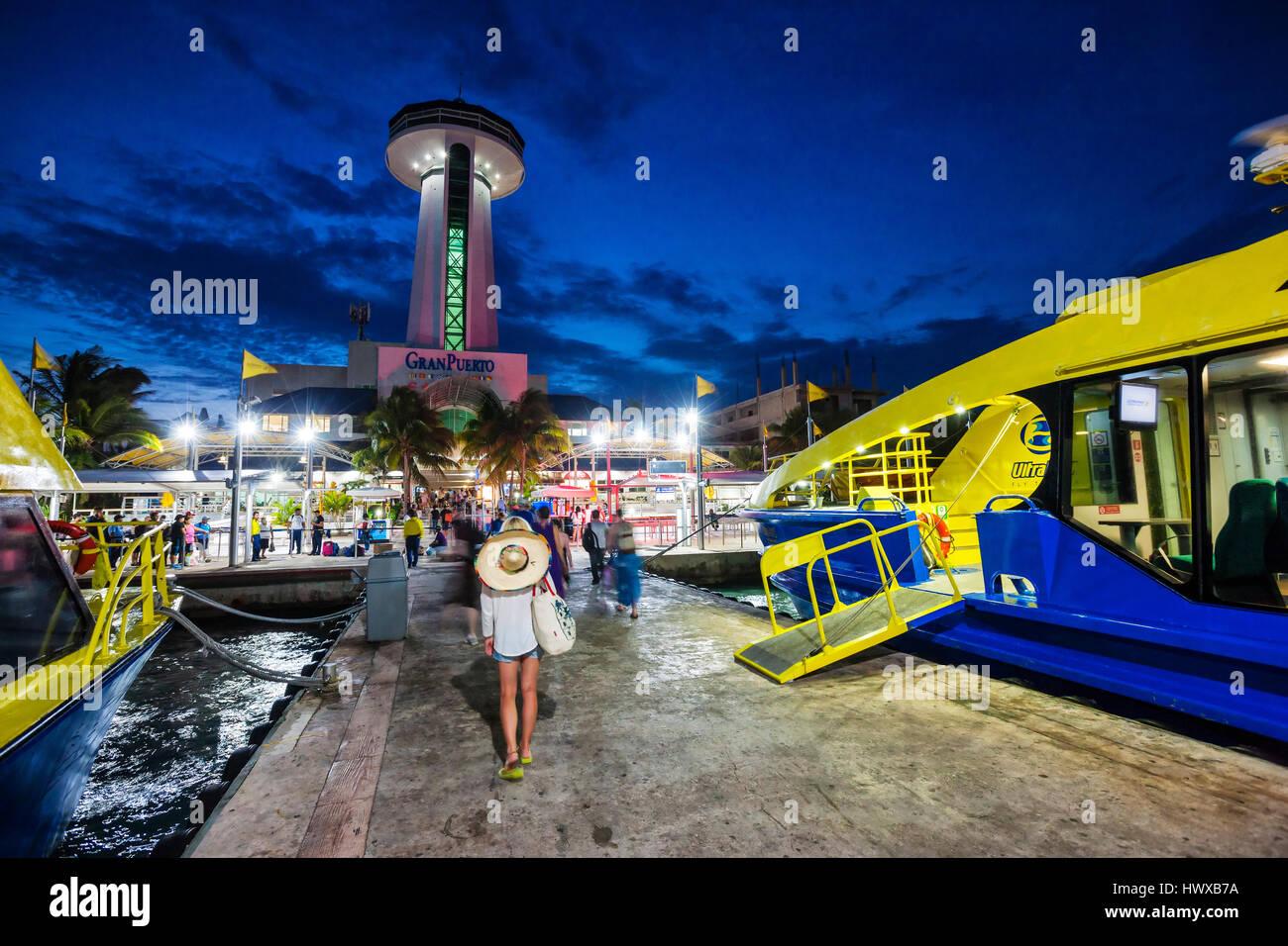 Cancun Puerto Juarez at night in Mexico.Tourists disembark. - Stock Image