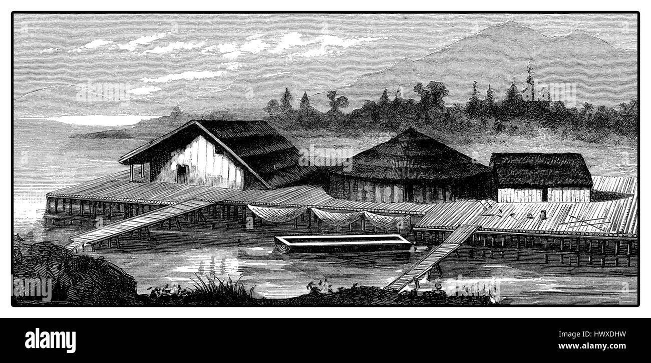 Reconstruction of a village of lake dwellings of Neolithic Age in Germany near lake Constance - Stock Image