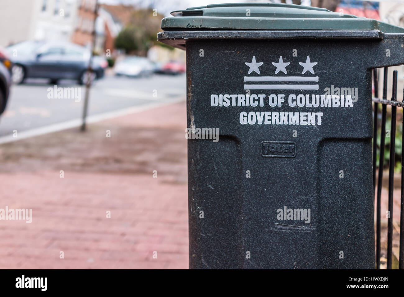 Washington DC, USA - March 20, 2017: District of Columbia government sign on trash can on street - Stock Image