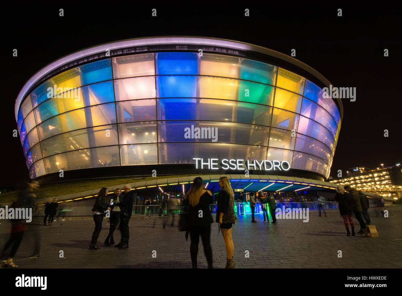 The SSE Hydro at the Scottish Event Campus - SEC - Glasgow, Scotland, UK at night - people standing outside - Stock Image