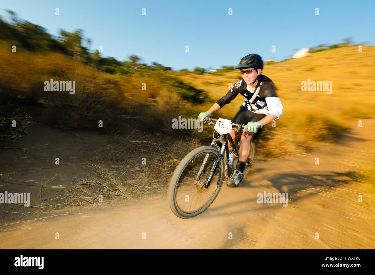 Mountain biker Nico Johnson races at Lake Hodges in north San Diego County. - Stock Image