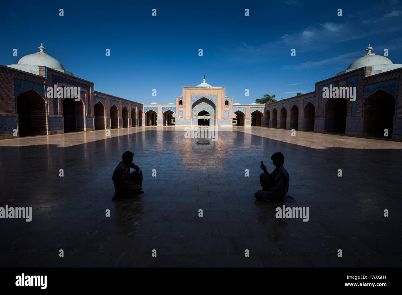 Boy takes a photo of his friend while on visit to Shah Jahan Mosque, Thatta Sindh. Mosque was gift to people of Stock Photo