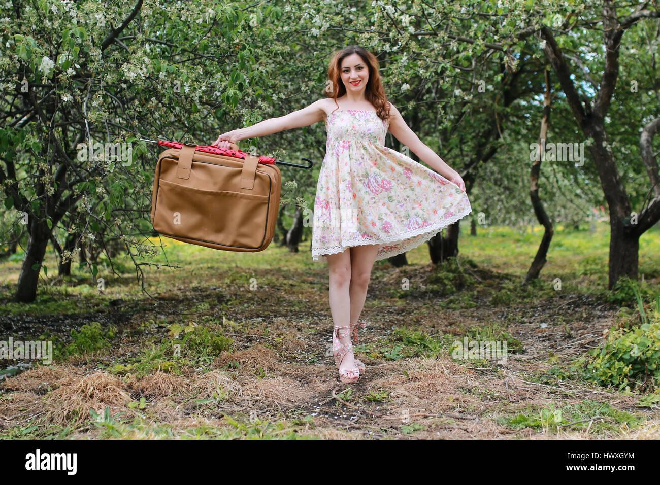 woman outdoor travel suitcase retro - Stock Image