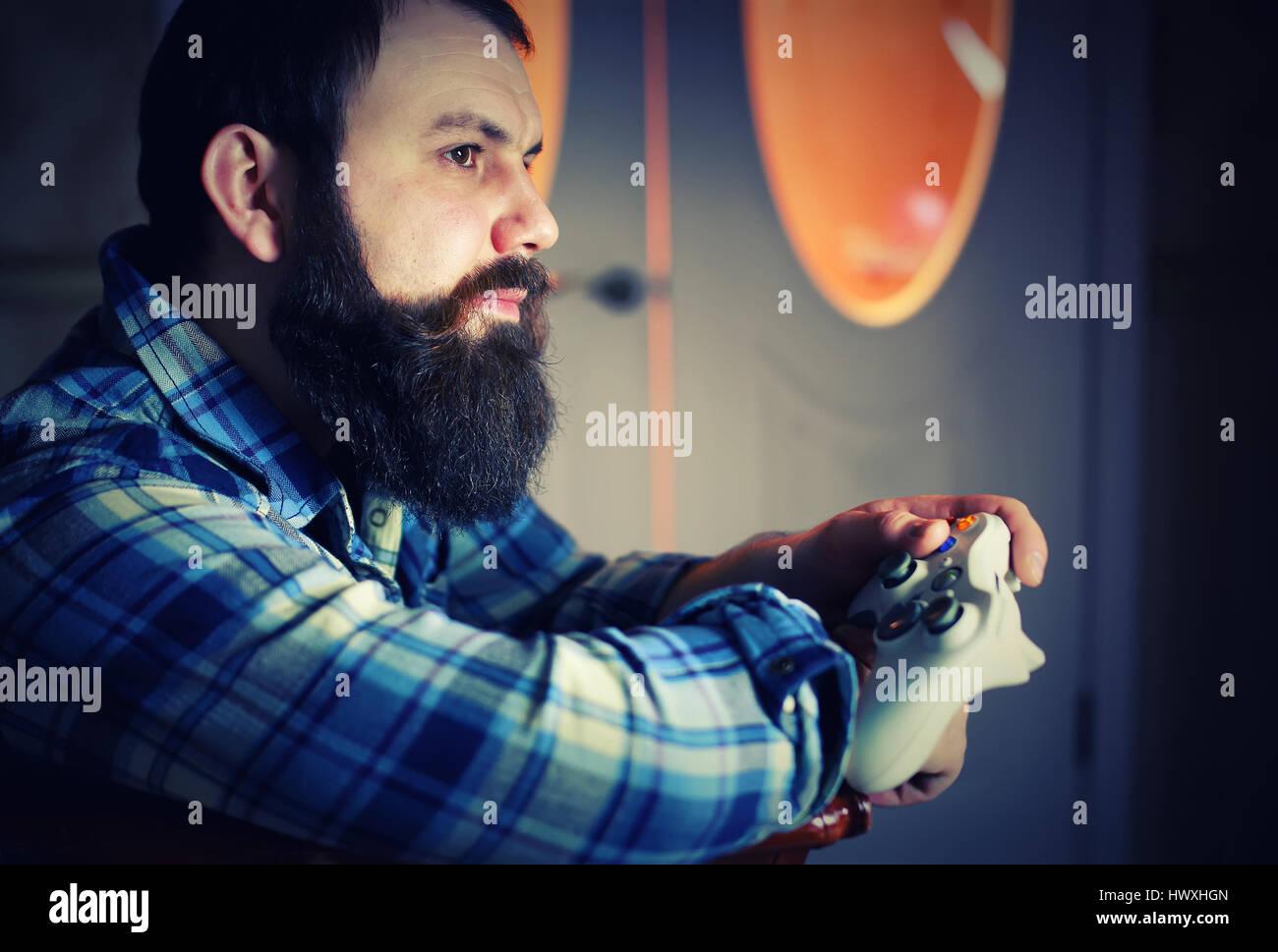 man bearded play joystick - Stock Image