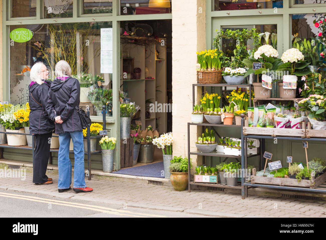 Cirencester oops a daisy florist shop full of spring flowers cirencester oops a daisy florist shop full of spring flowers ideal for mothers day as couple of women look in window at cirencester in march izmirmasajfo