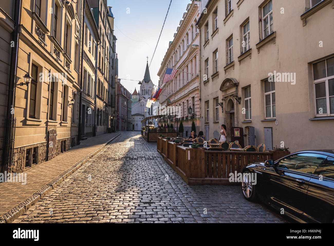 Pils iela (Pils Street) on the Old Town of Riga, capital city of Republic of Latvia. Our Lady of Sorrows Church - Stock Image