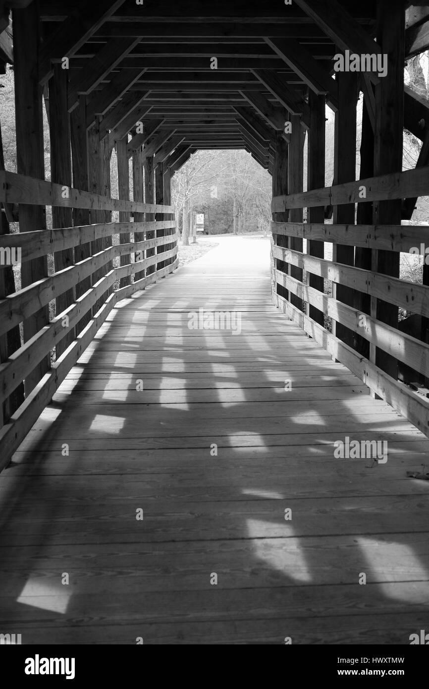 Covered bridge in park - Stock Image
