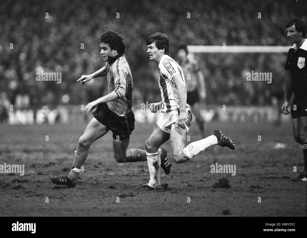 Footballers Hugh Atkinson and Paul Bracewell in action Stoke City v Wolverhampton Wanderers 03 January 1981 - Stock Image