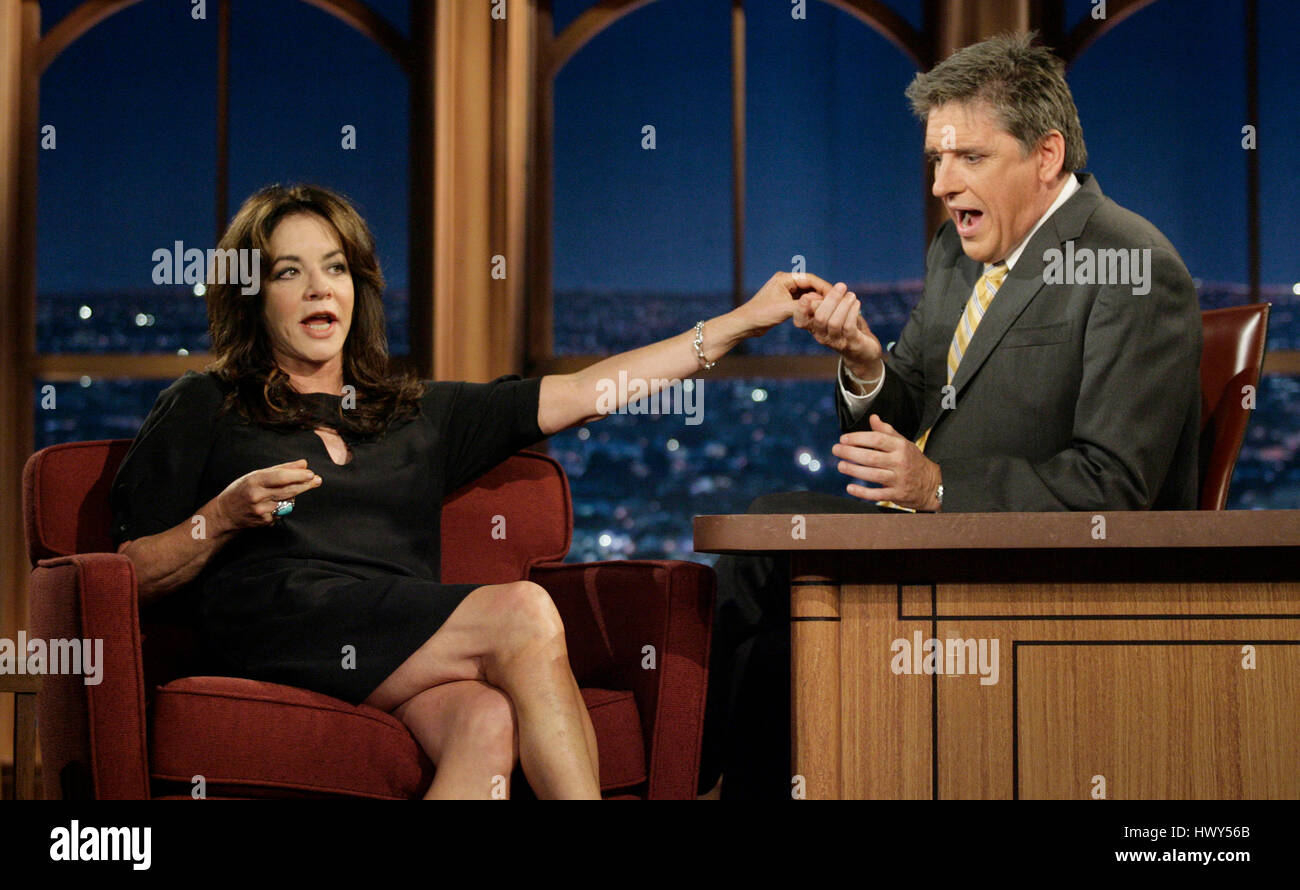 Actress Stockard Channing, left, gives host Craig Ferguson some candy during a segment of 'The Late Late Show - Stock Image