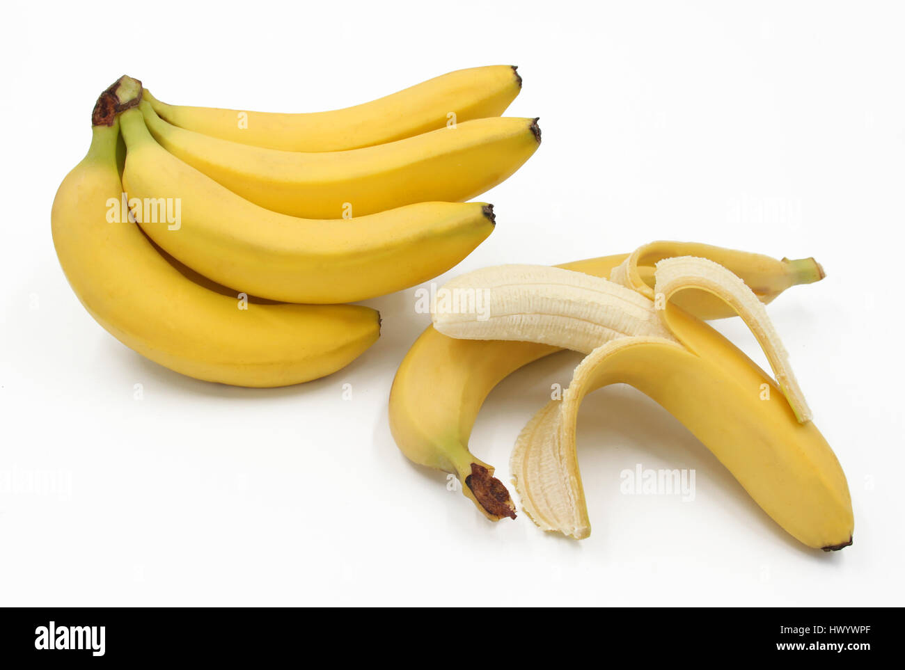 Bunch of ripe bananas - Banana peeled and unpeeled - spotless flawless - Background isolated white Stock Photo