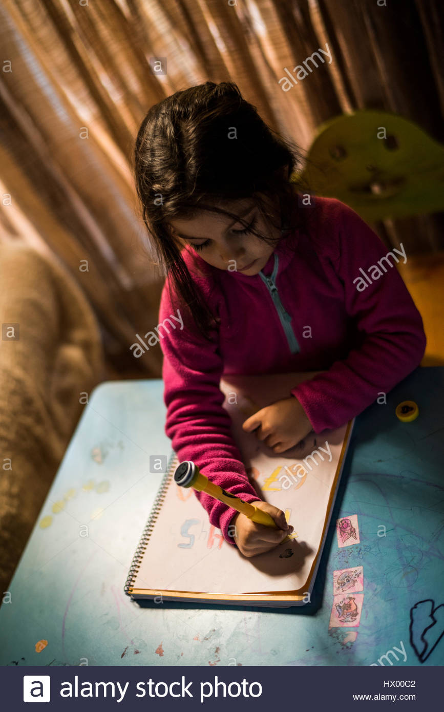 Little girl drawing numbers - Stock Image