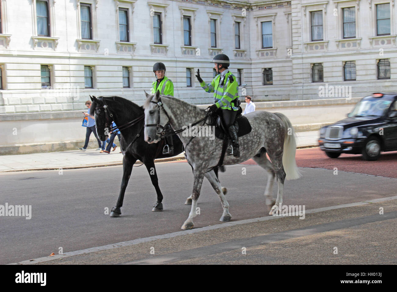 Mounted Police passing Horseguards Parade in London, England, UK Stock Photo