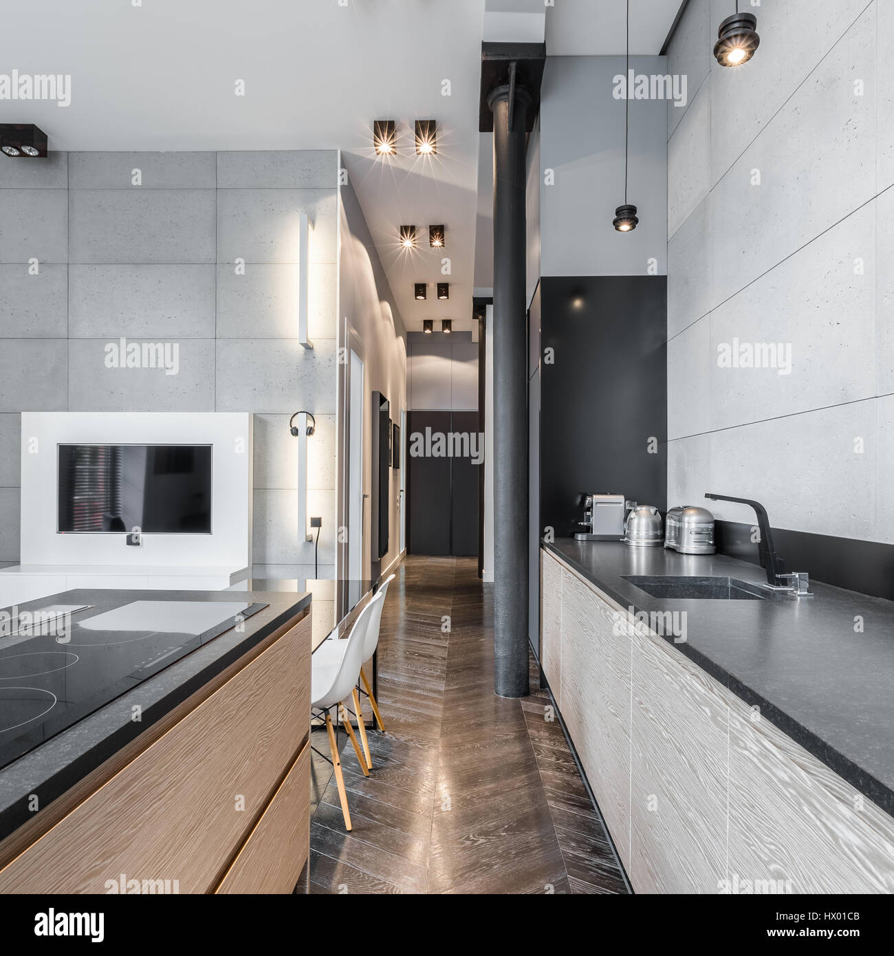 Functional kitchen with black long worktop and ceiling ...