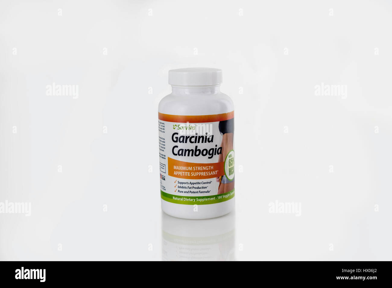 A bottle of Garcinia Cambogia appetite suppressant capsules on a white background. Cutout. USA. - Stock Image