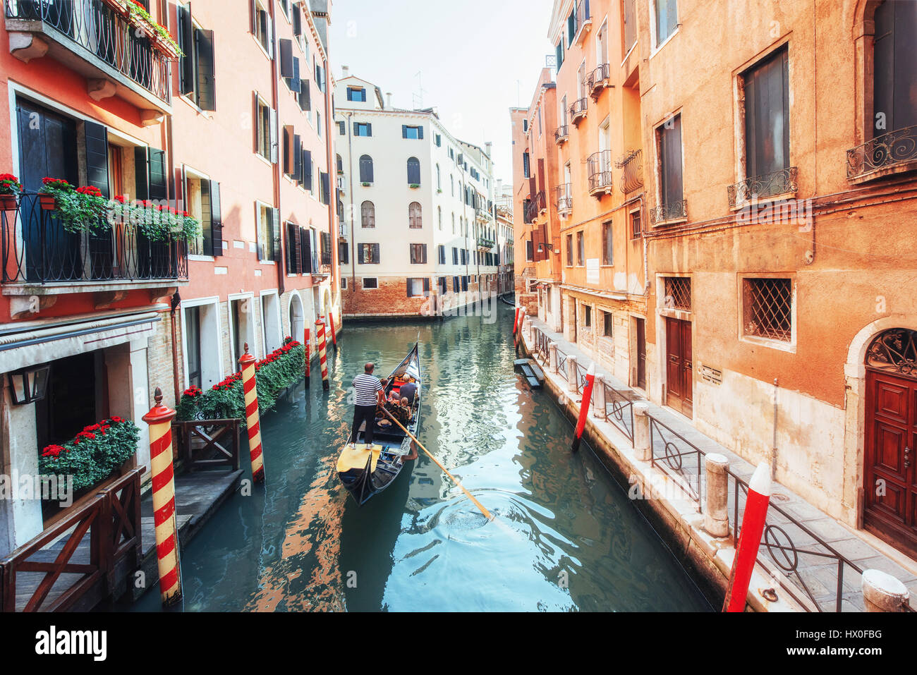 Gondolas on canal in Venice. Venice is a popular tourist destination of Europe - Stock Image