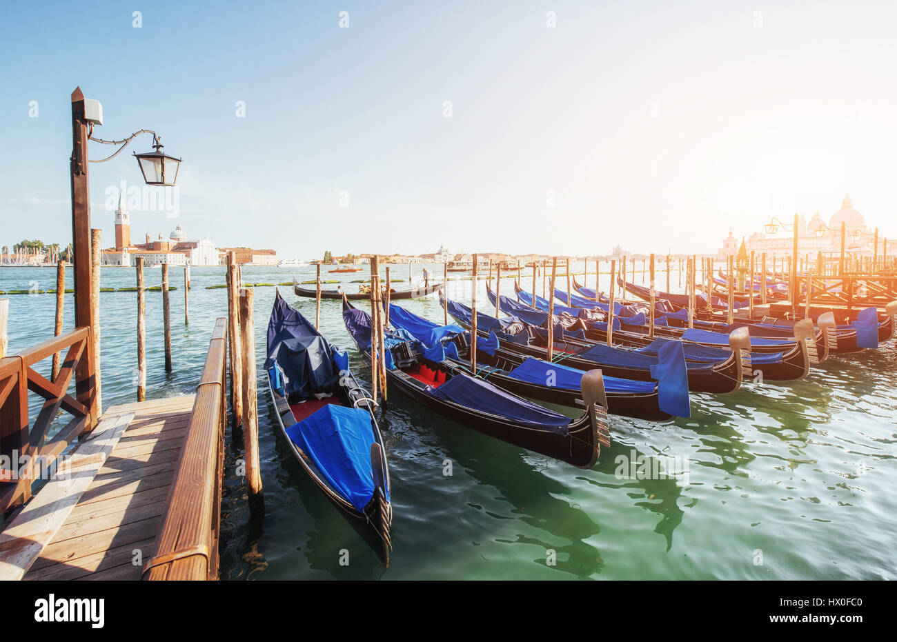 Gondolas on Grand canal in Venice, San Giorgio Maggiore church. San Marco. Beautiful summer landscape Stock Photo