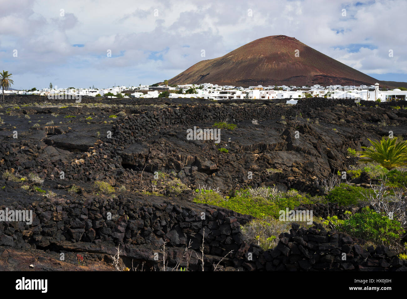 view on the typical Landscape and the La Woerden Volcano near Tahiche, Lanzarote, Spain - Stock Image