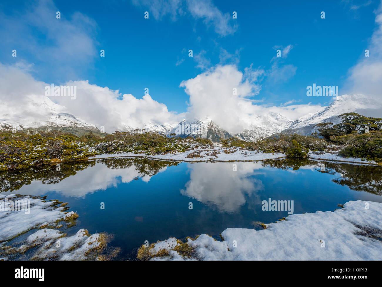 Snow on summit of Key Summit, Mt. Christina, Fiordland National Park, West Coast, Southland, New Zealand - Stock Image