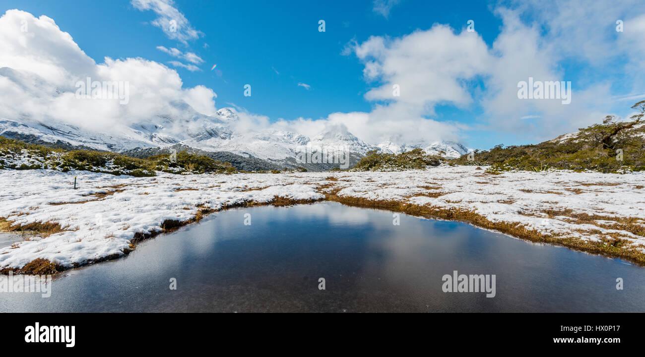 Mountain lake at the summit of Key Summit, Fiordland National Park, West Coast, Southland, New Zealand - Stock Image