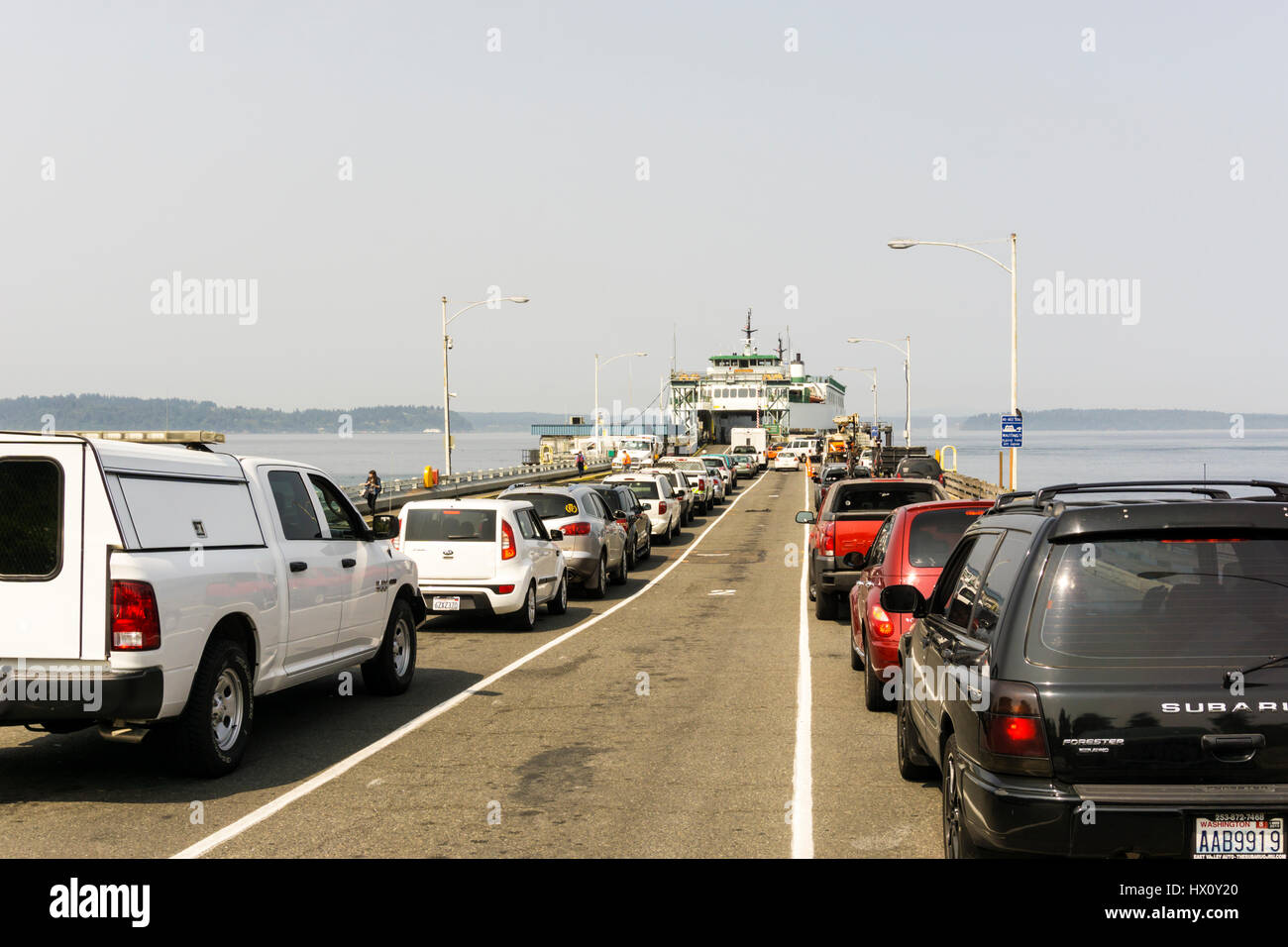 Queue of cars at Fauntleroy in West Seattle waiting to board MV Sealth to cross Puget Sound. - Stock Image