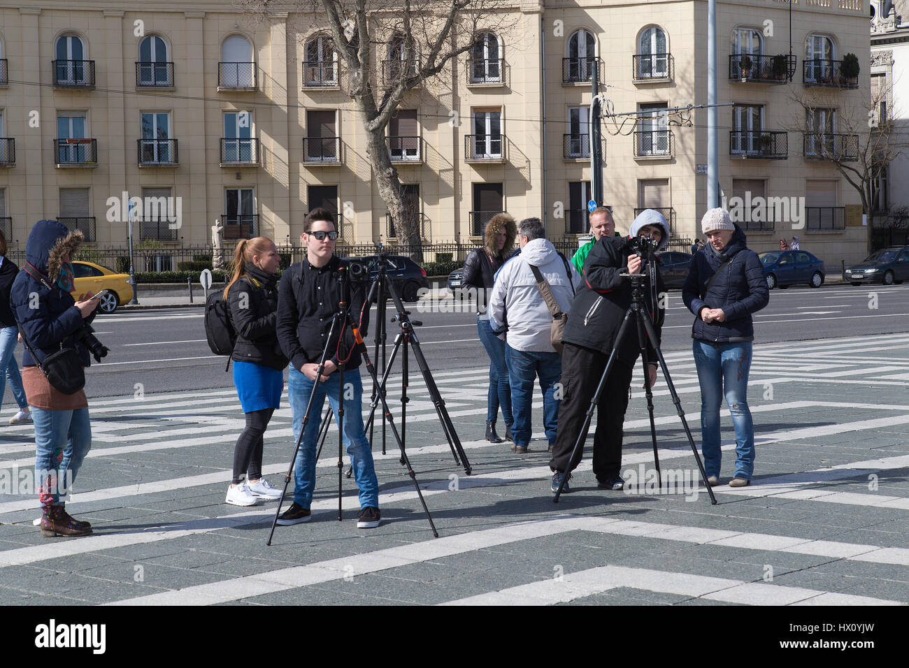 A group of young people with cameras on tripods Heroes Square in Budapest Hungary - Stock Image
