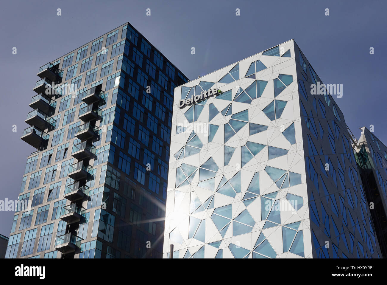 The modern office building Deloitte Headquarter is located at the waterfront at the Bjørvika neighbourhood - Stock Image