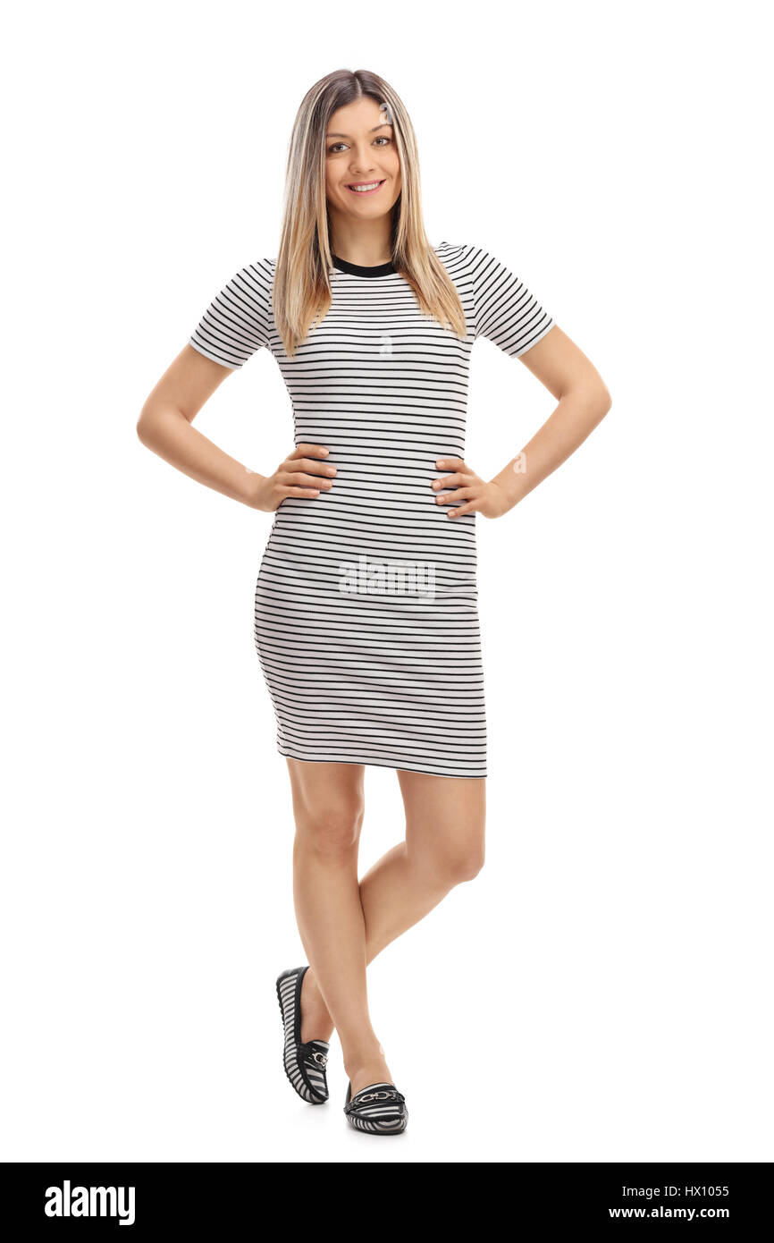 8f1ea6fa7eaf Full length portrait of a young woman in a tight dress looking at the  camera and