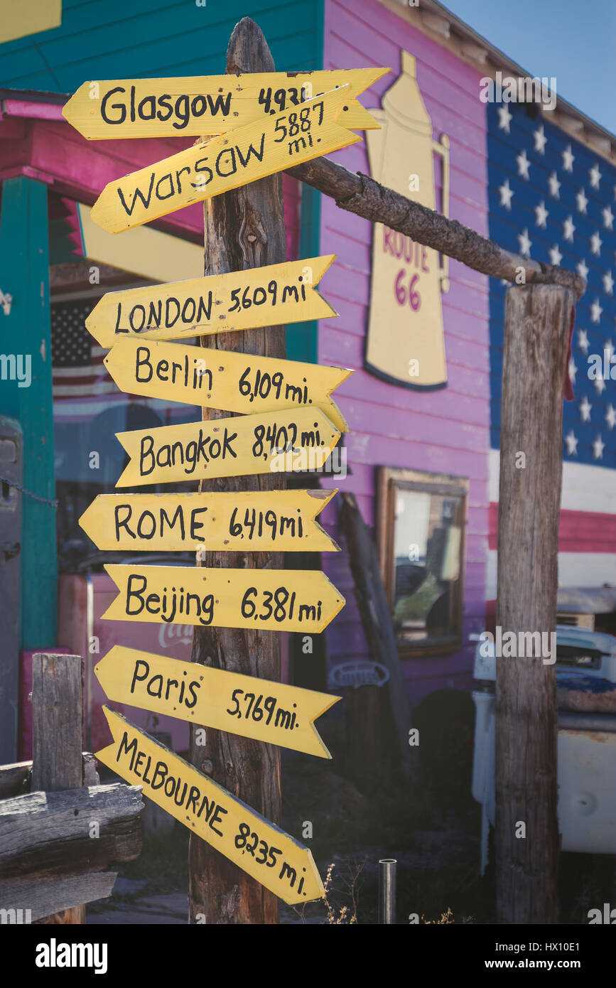 USA, Arizona, Seligman, signpost with capital cities at Route 66 - Stock Image
