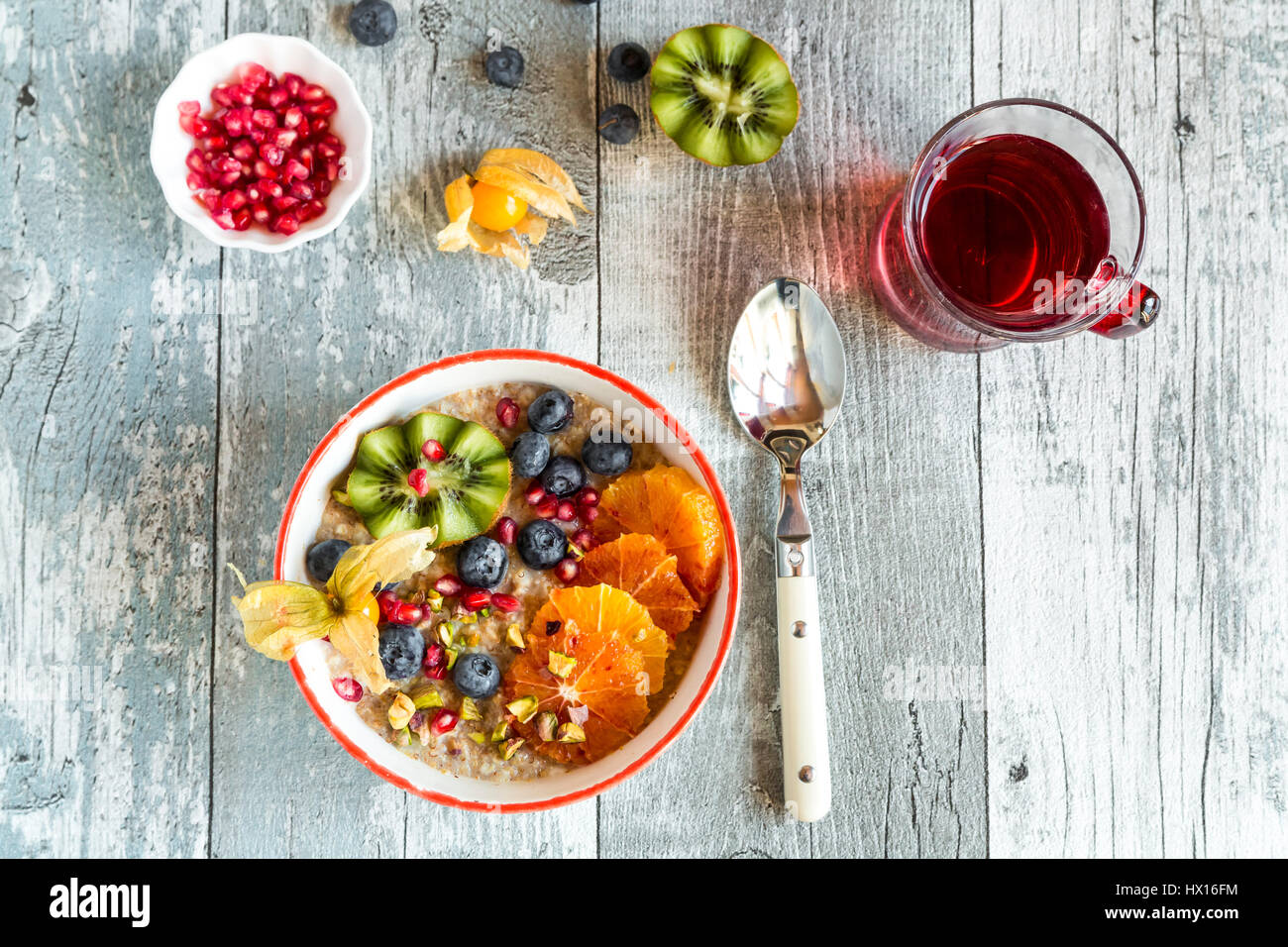 Superfood breakfast with porridge, amaranth, various fruits and pistachios - Stock Image