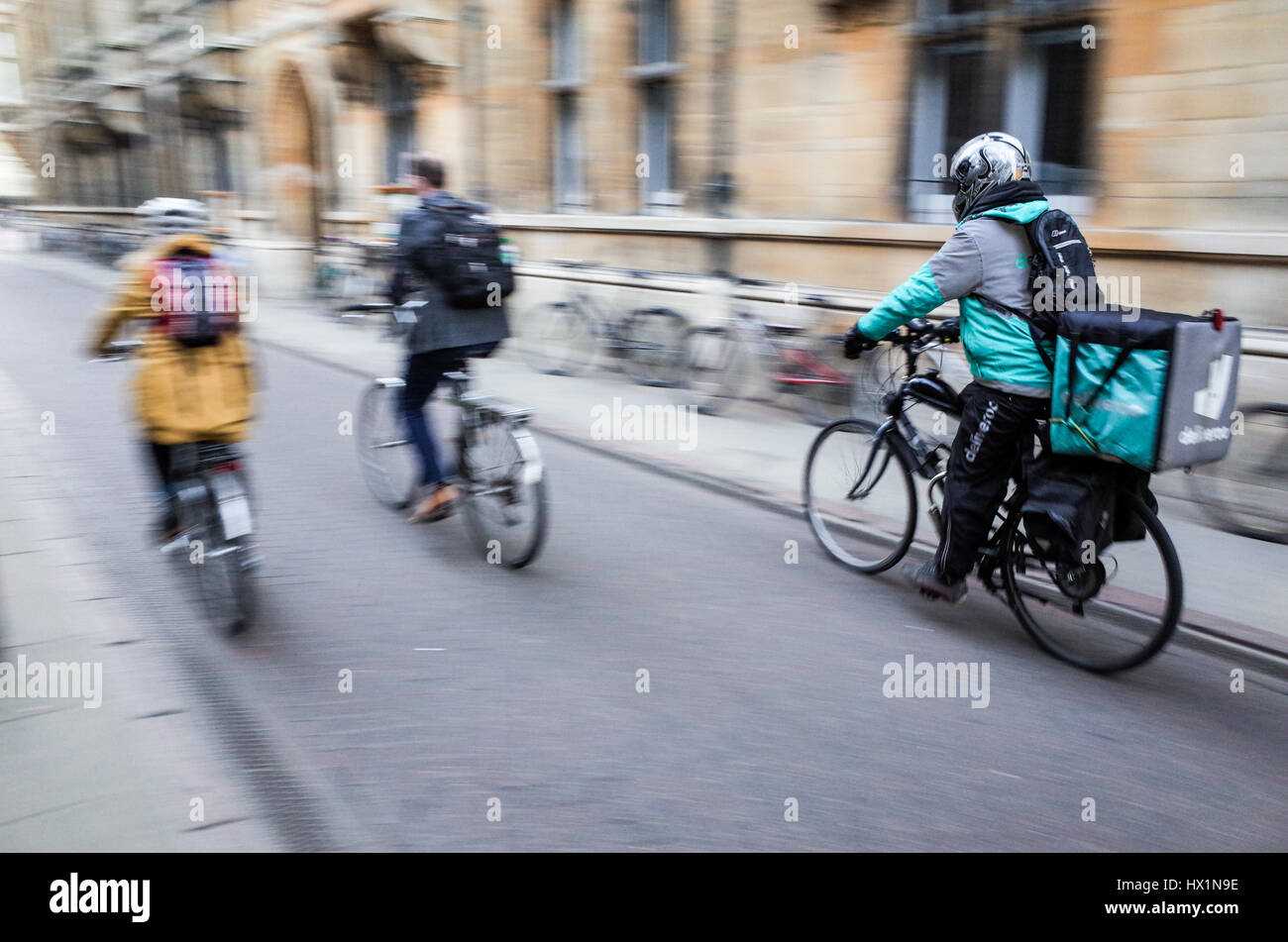 3582e17fbfd A Deliveroo food courier rushes through the streets of Cambridge, UK, to deliver  takeaway