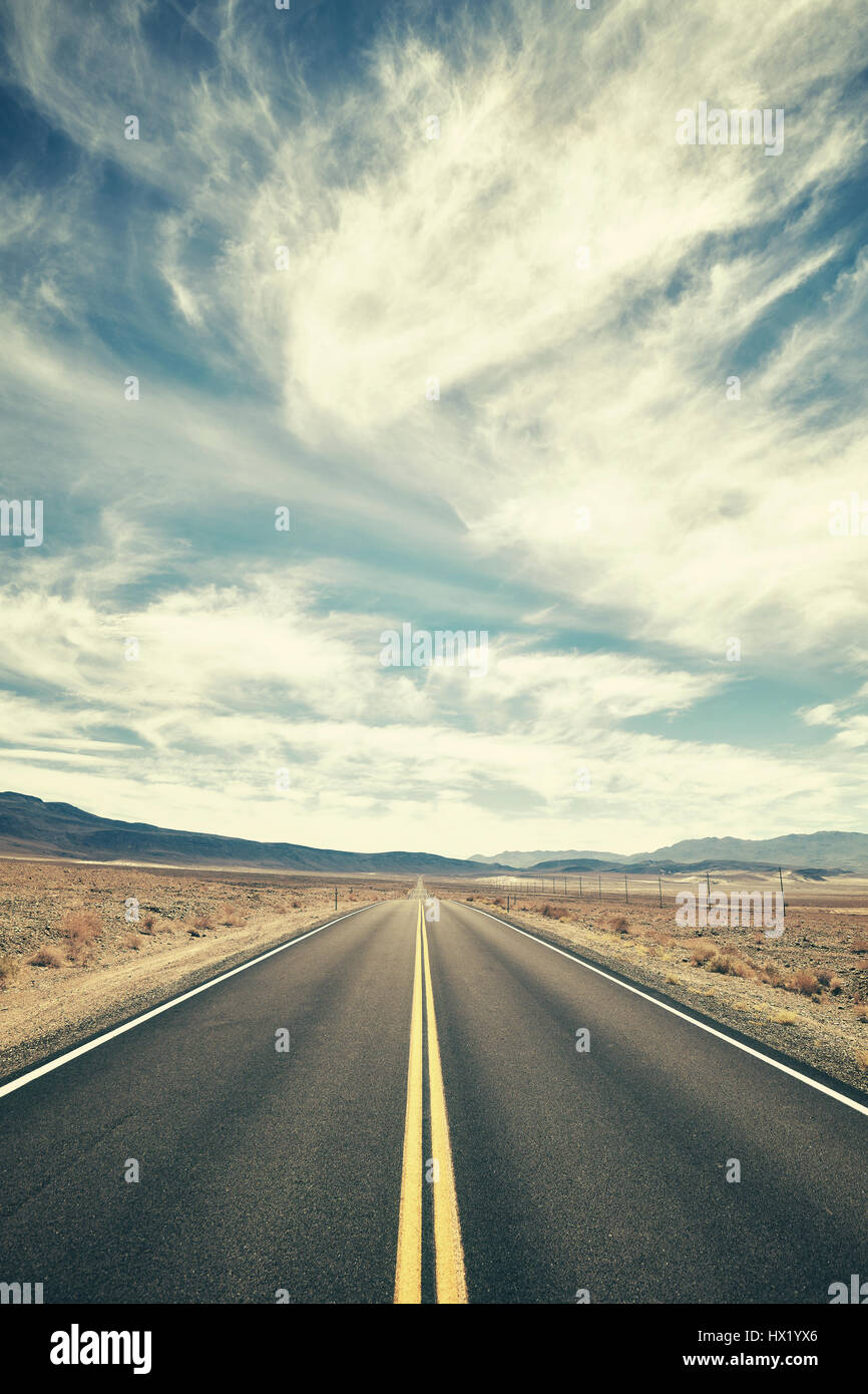 Vintage toned desert road in Death Valley, travel concept, USA. - Stock Image