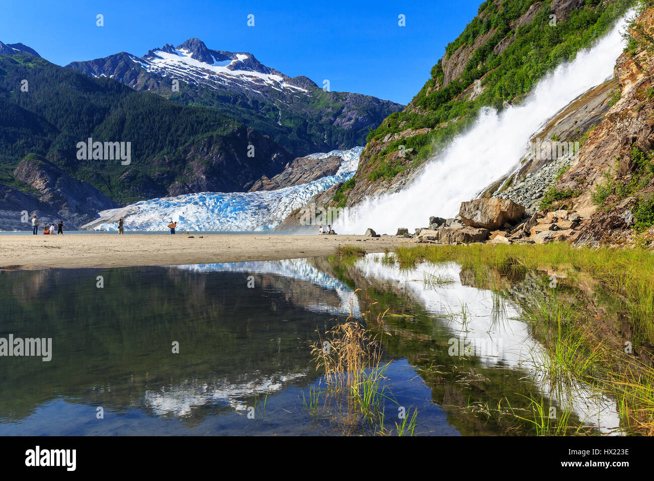 Juneau, Alaska. Mendenhall Glacier Viewpoint with reflection in the lake and waterfall. Stock Photo