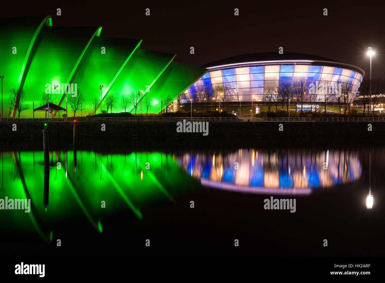 The SSE Hydro and SEC Armadillo at The Scottish Event Campus (SEC), Glasgow, Scotland, UK at night - reflected in - Stock Image