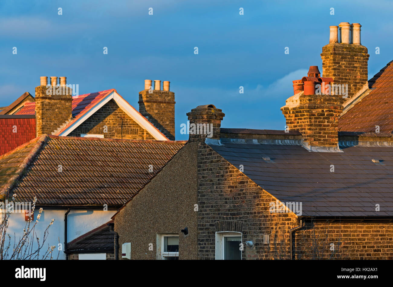 Rooftops and chimneys. Evening light. Croydon South London UK - Stock Image