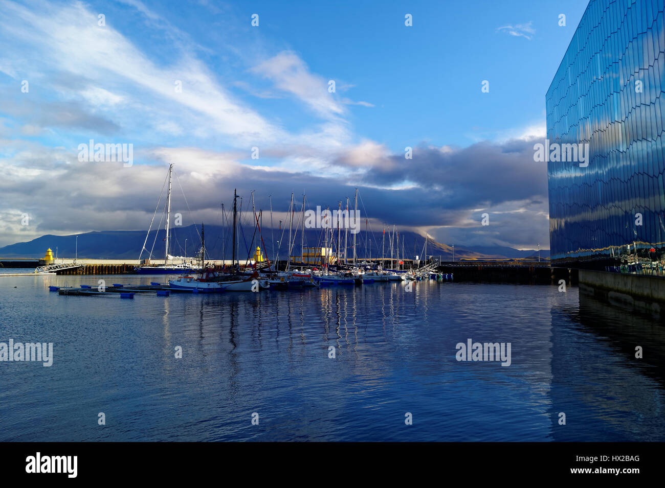 Port of Reykjavik. The sky is reflected in the water. Yachts in the port of Reykjavik - Stock Image