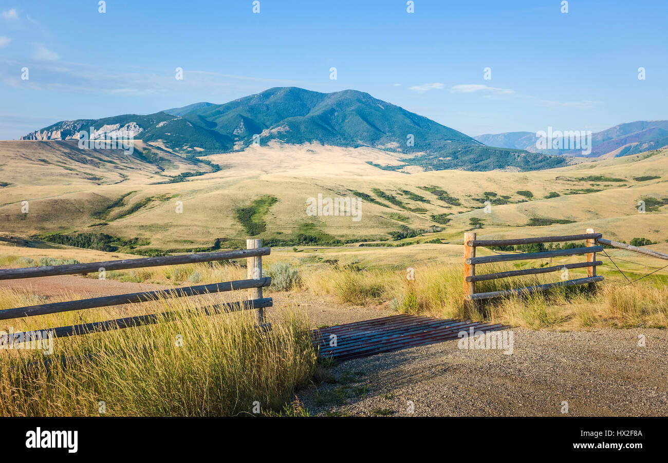 Foothills of Bear Tooth Mountains on a summer day with sagebrush and grassland as viewed from the Bear Tooth Mountain - Stock Image