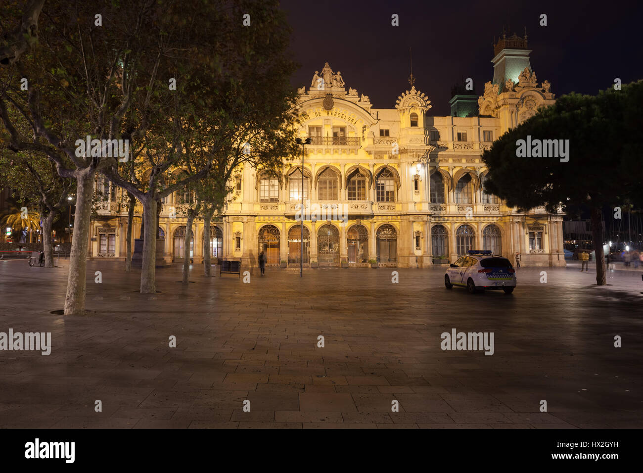 Headquarters building of the Port Authority of Barcelona at night in Catalonia, Spain - Stock Image