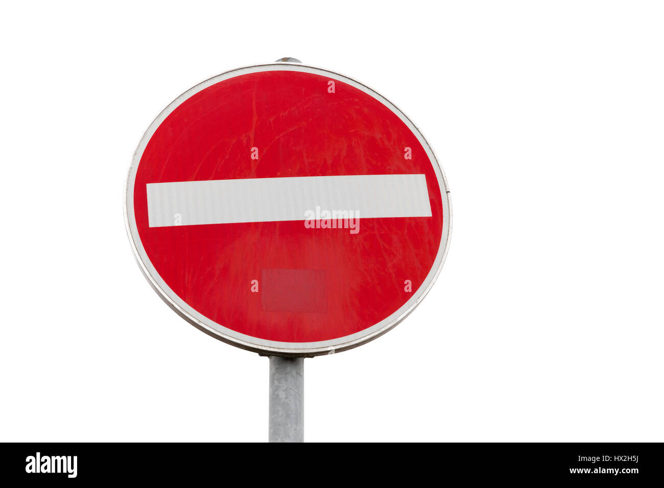 Round red sign No Entry road sign isolated on white background, close up photo - Stock Image