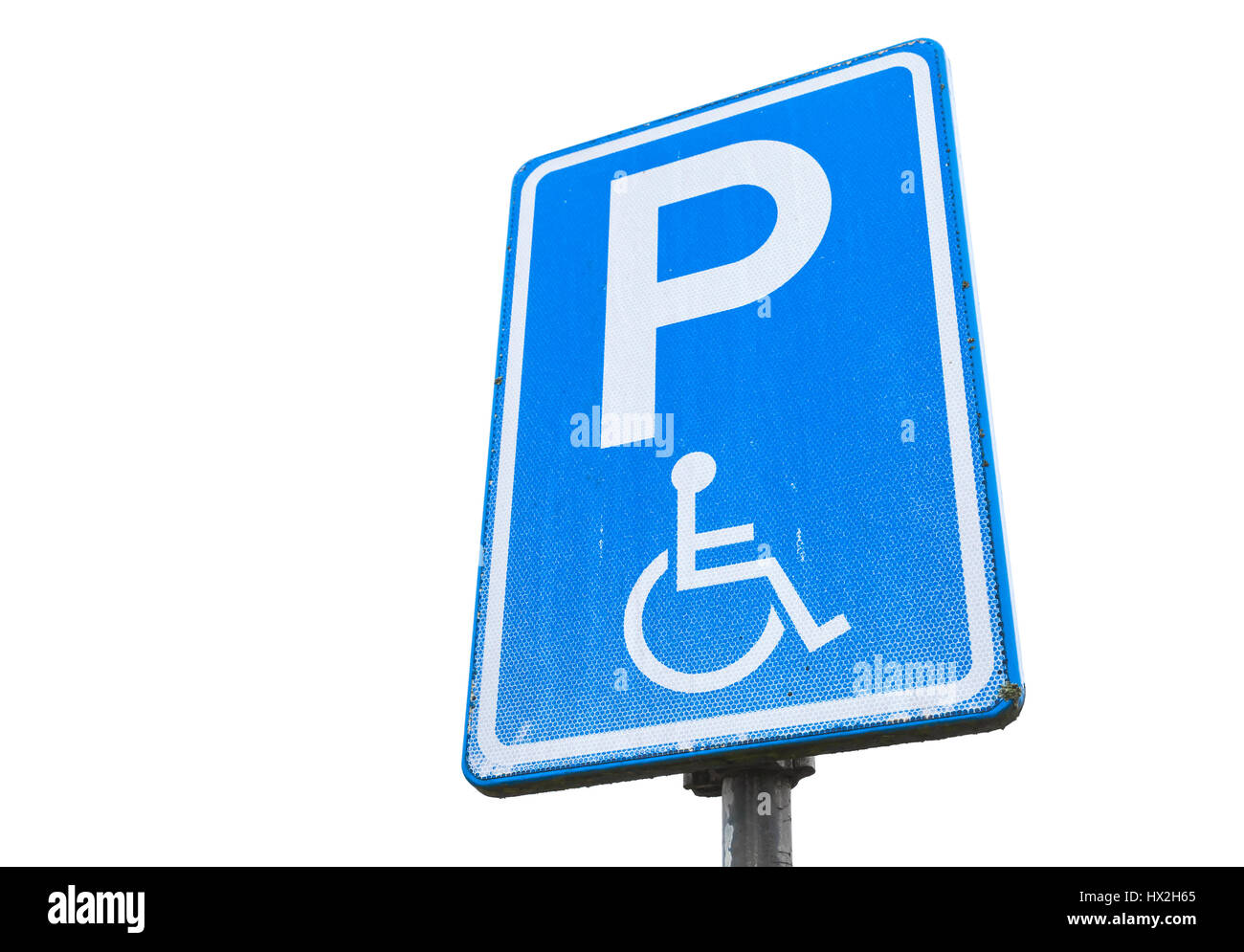 Disabled parking permit, blue road sign isolated on white background, close up photo - Stock Image
