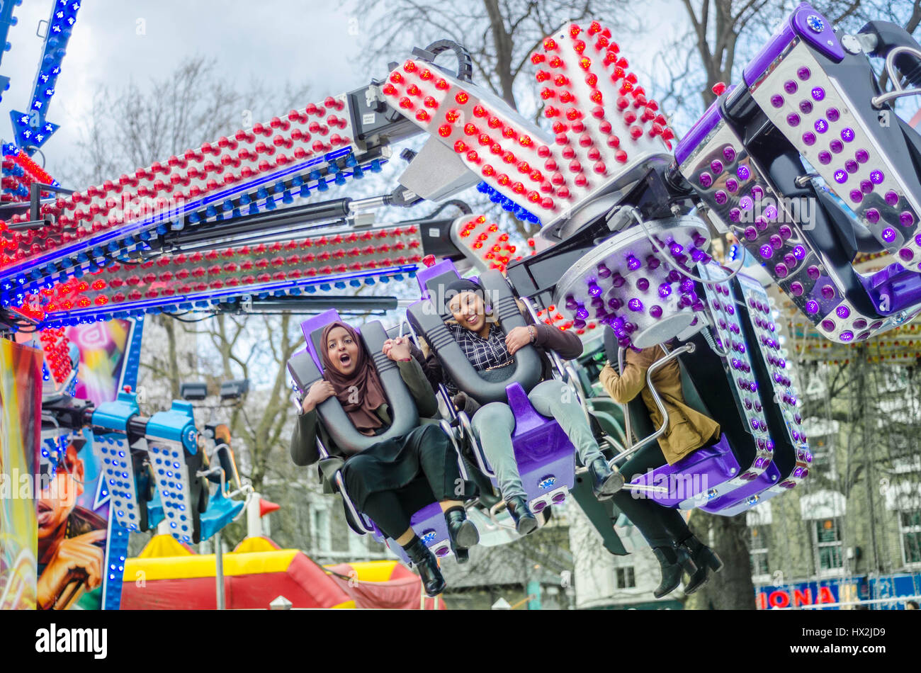 An orbiter ride at a fairground on Shepherds Bush Green in London, England - Stock Image