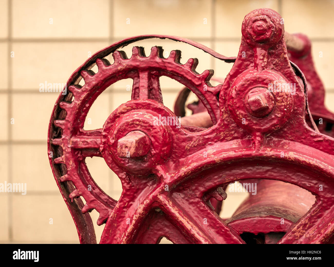 Close up detail of old rusting red gear dockside mechanism, Leith harbour, Leith, Edinburgh, Scotland, UK - Stock Image
