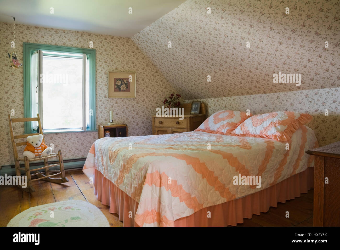 Queen Size Bed With Orange Bedspread And Furnishings In Bedroom Of Stock Photo Alamy
