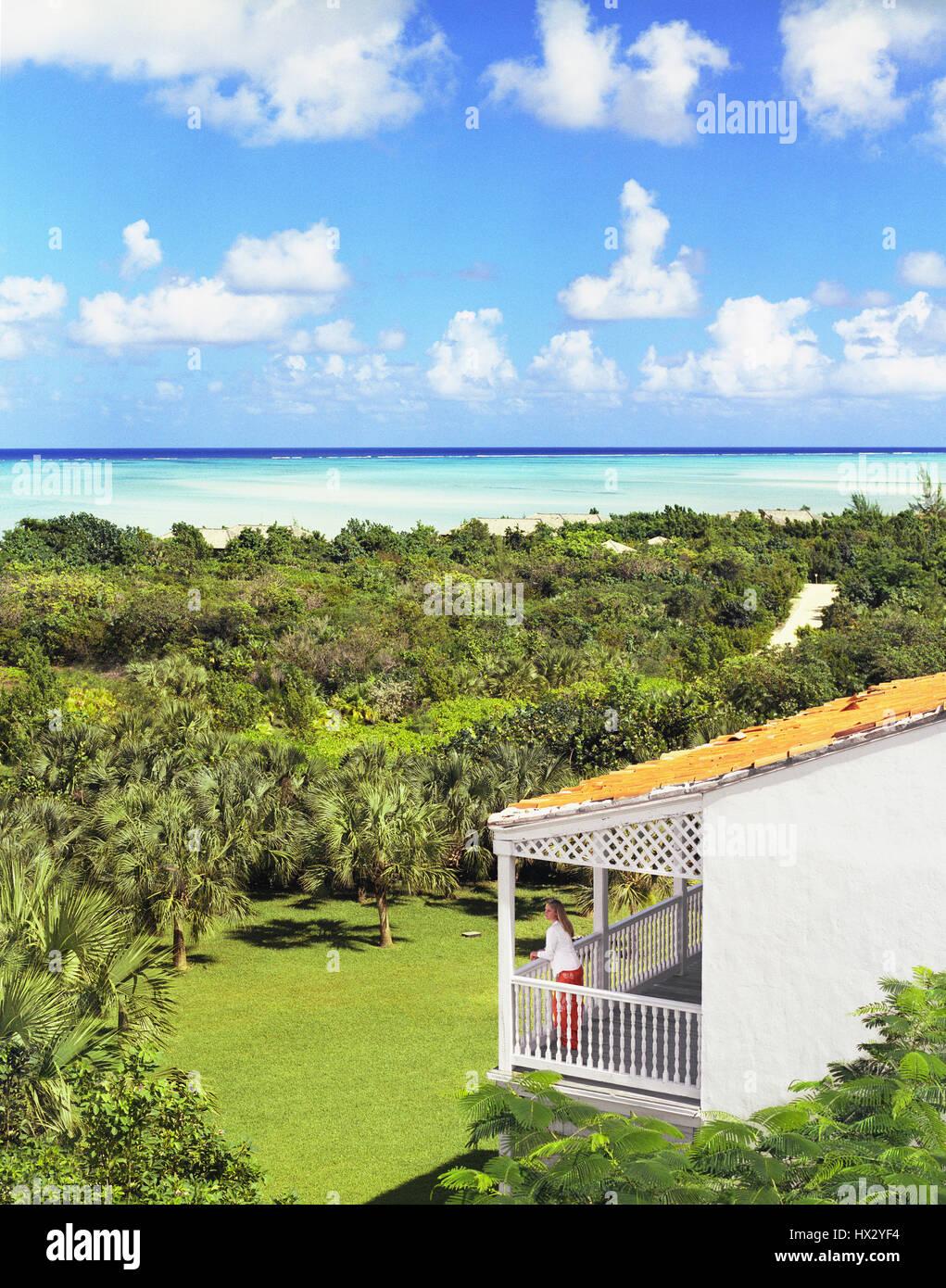 Woman standing on verandah , Turks and Caicos - Stock Image