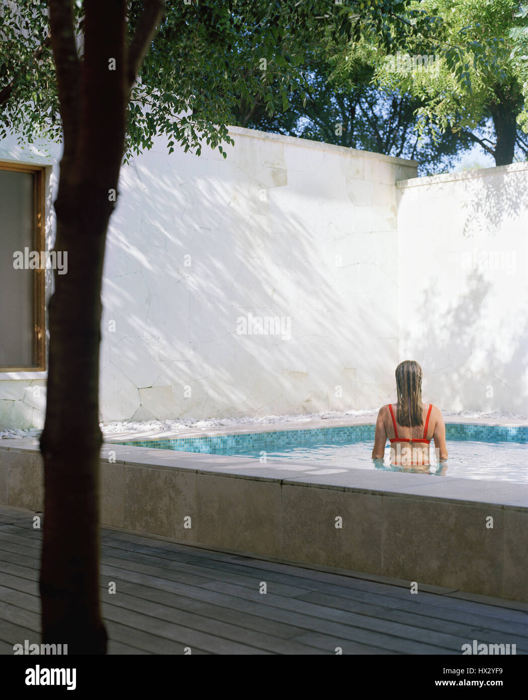 Back view of woman in pool , Turks and Caicos Stock Photo