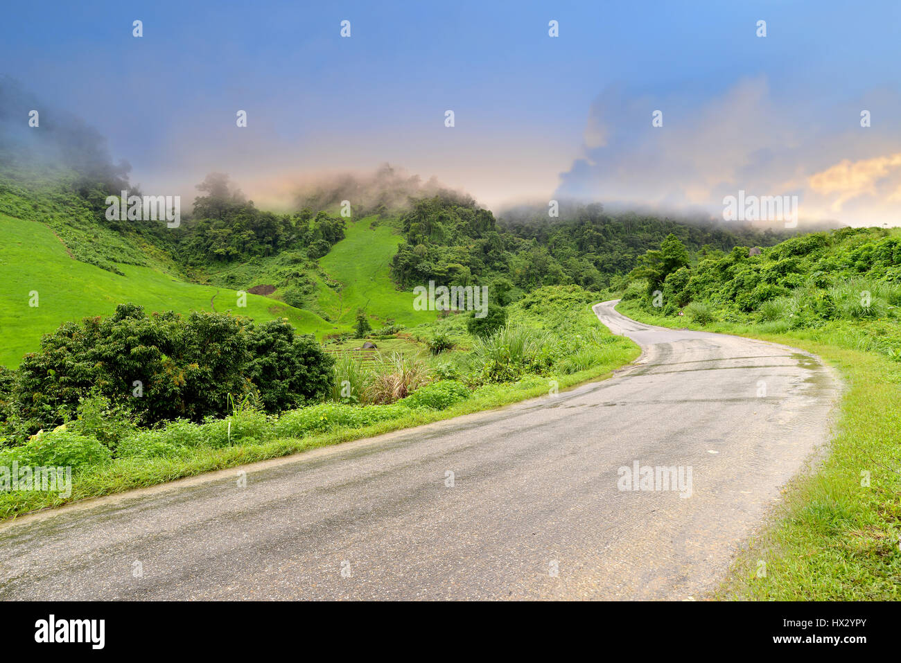Mountain road view in the north of Laos wide and cloudy low lighting after raining - Stock Image
