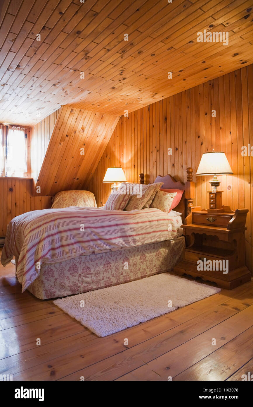 Raised single bed in bedroom with knotted pinewood walls in ... on large log home, natural log home, treated log home, painted log home, flat log home, single log home, smooth log home, restored log home, small log home, standard log home, square log home, solid log home, plain log home,