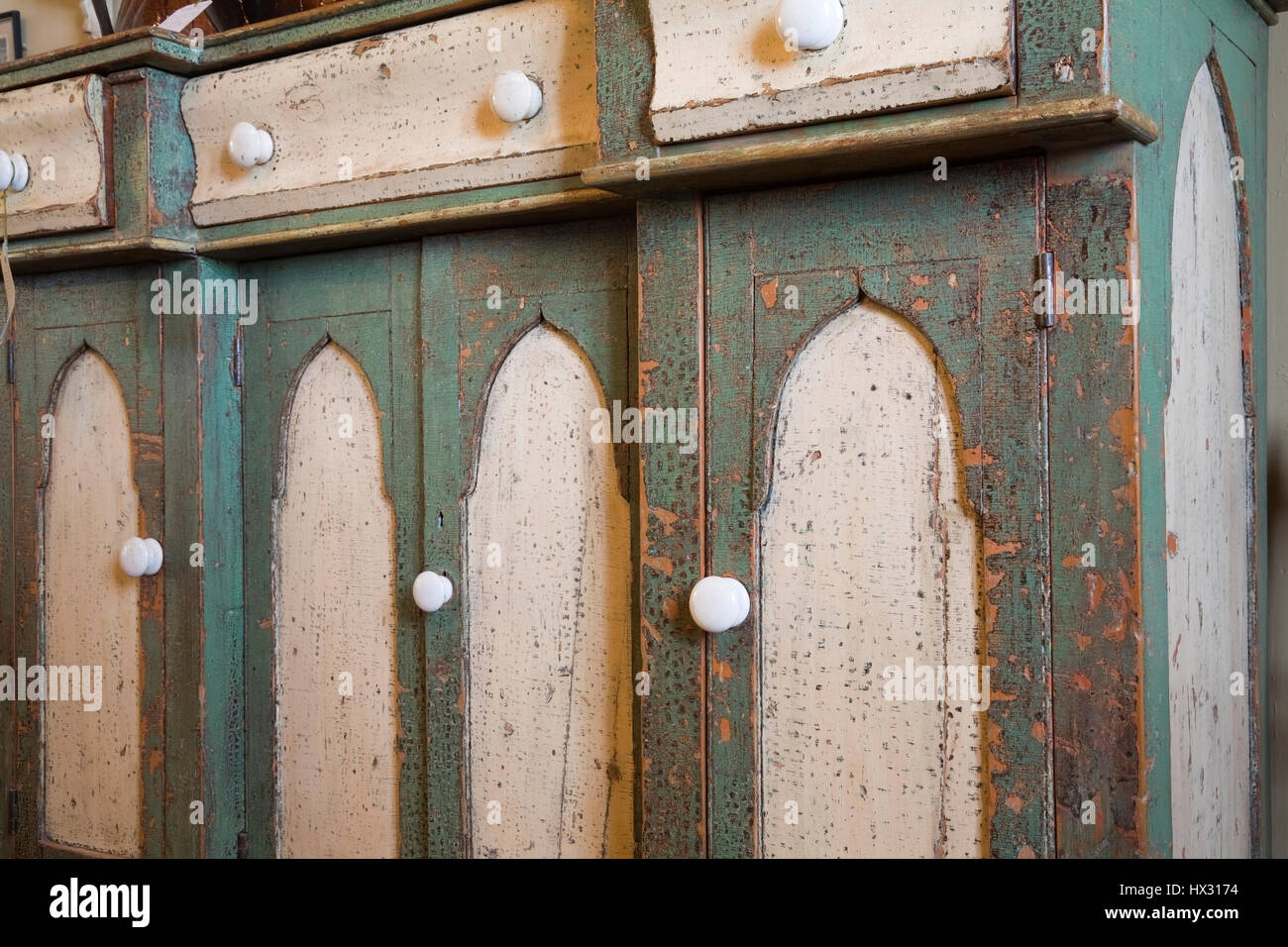 antique stores close by Close up of green and white antique wooden buffet in antique store  antique stores close by