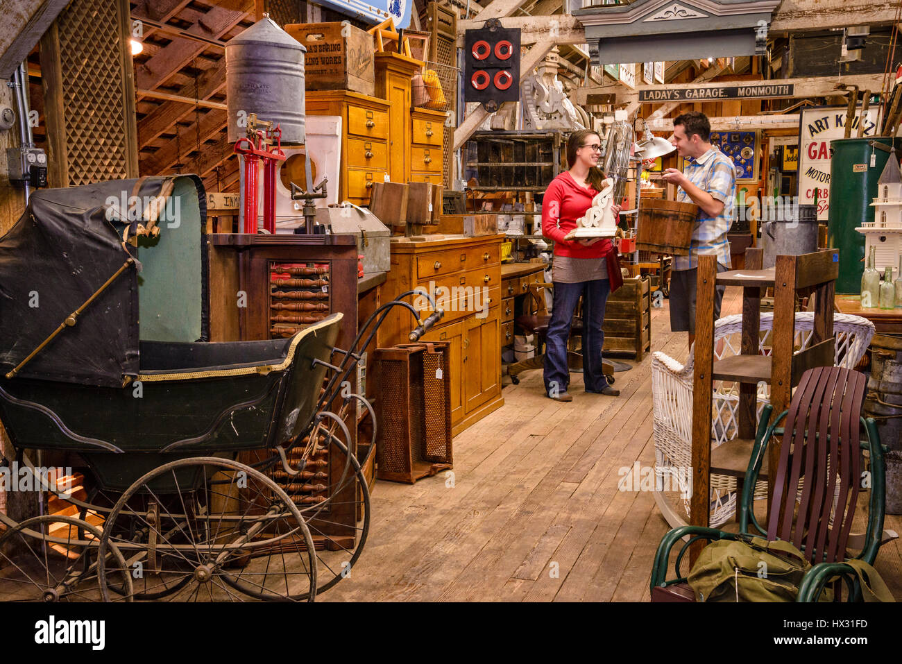 Young adult couple shopping at Aurora Mills Architectural Salvage in Aurora, Oregon. - Stock Image