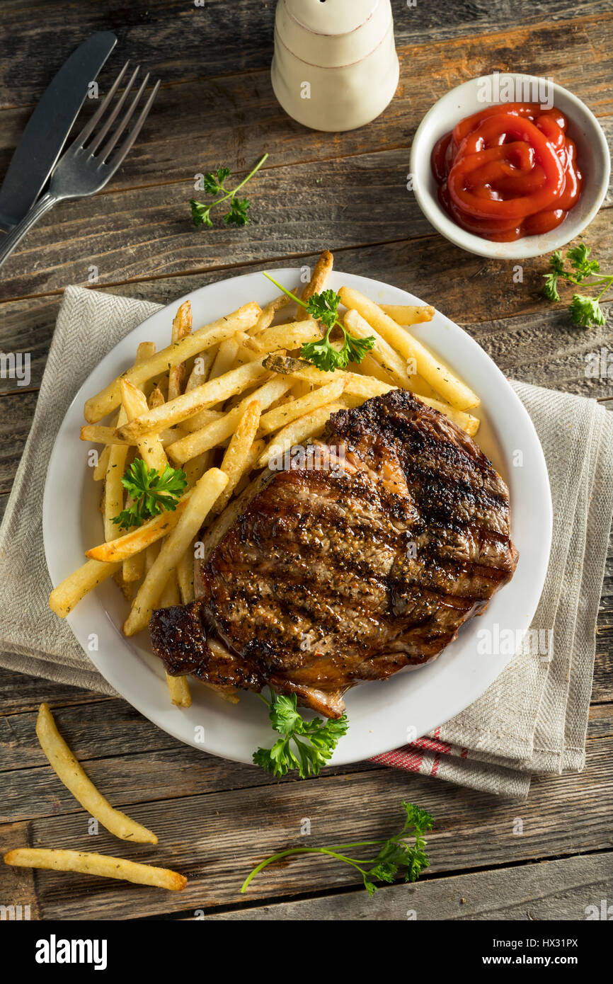 Hearty Homemade Steak and French Fries Ready to Eat - Stock Image